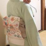 賀詞交換会の着物。椿の訪問着に綴れ帯。